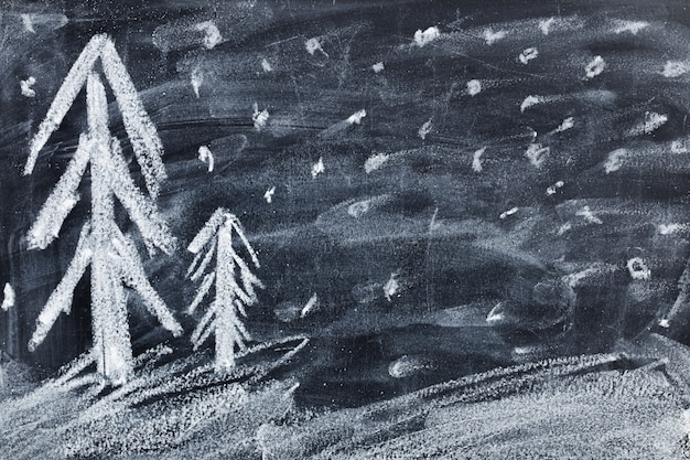 黒い黒板に描くクリスマス子供チョーク