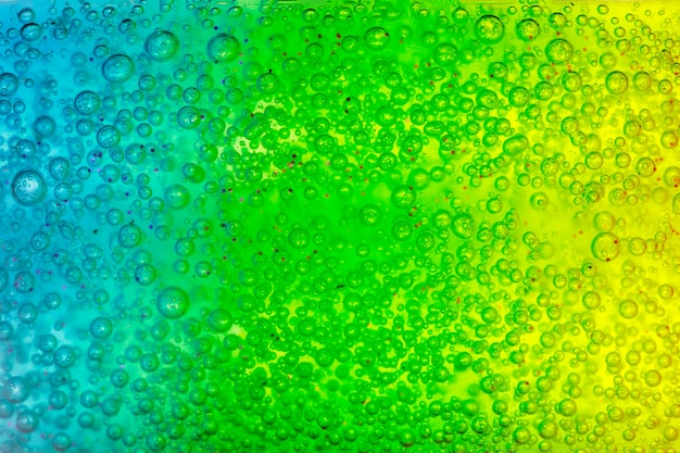 Абстрактная текстурированная поверхность с синим и зеленым гелем