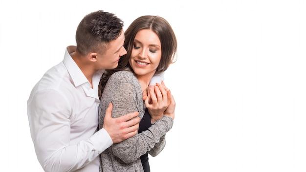 夫婦。男は女性を押しながらカメラ目線します。妊娠、カップルの目標、幸福、機能、夢、女性の健康の概念。