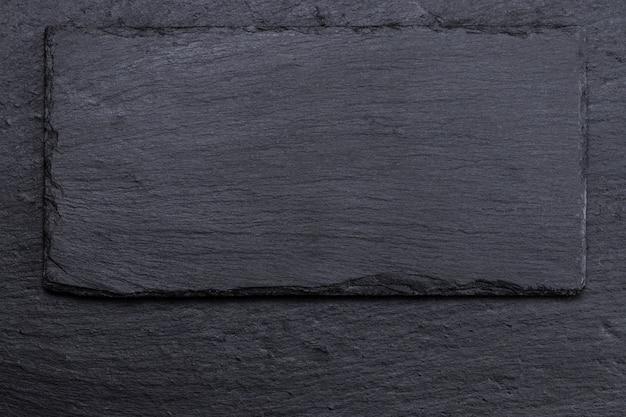 Камень черный сланец фоновой текстуры