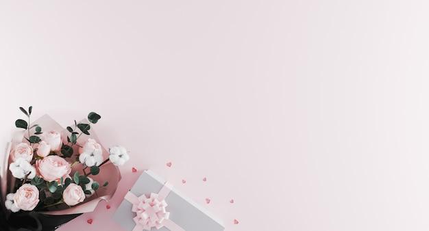 明るいピンクの背景にピンクのリボンと白いプレゼントボックスと牡丹の美しいモダンな花束。