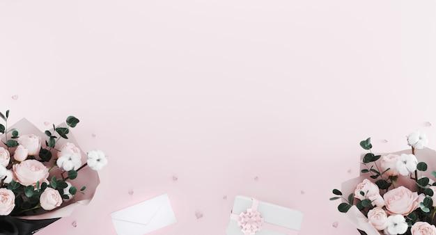 Пастельно-розовый романтический фон с пионами букетов, конфетти в форме сердца, письмо и белая подарочная коробка с розовой лентой.