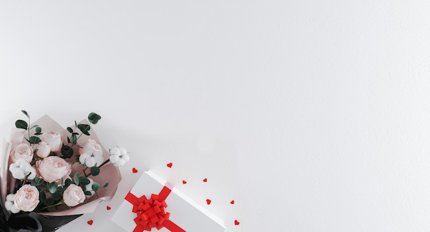 赤いリボンと白い背景の上のハート型の紙吹雪と白いギフトボックスに花の美しい花束。バレンタイン・デー