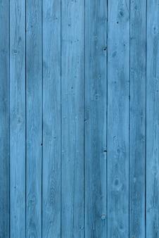 青い木製の背景、古い時代の効果、古いビンテージボードは水色に塗装
