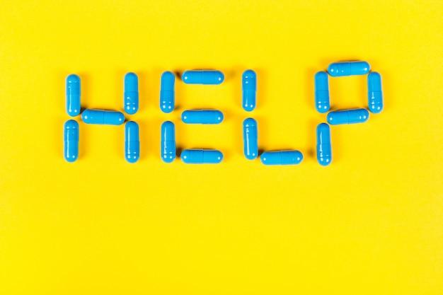 Слово «помощь» на желтом фоне