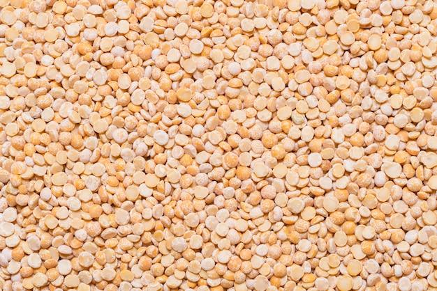 黄色のエンドウ豆をクローズアップ、テクスチャ背景