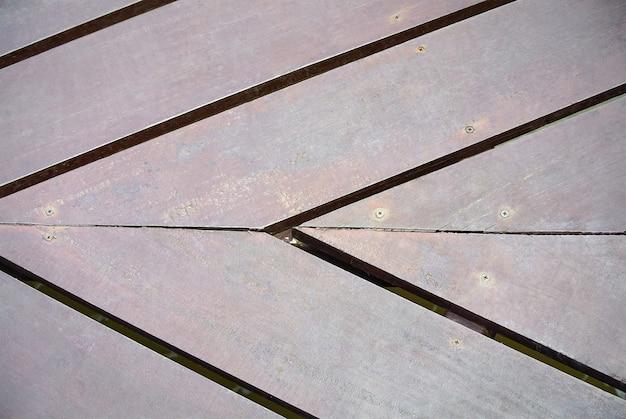 接続点で木の板の床のフルフレームの背景