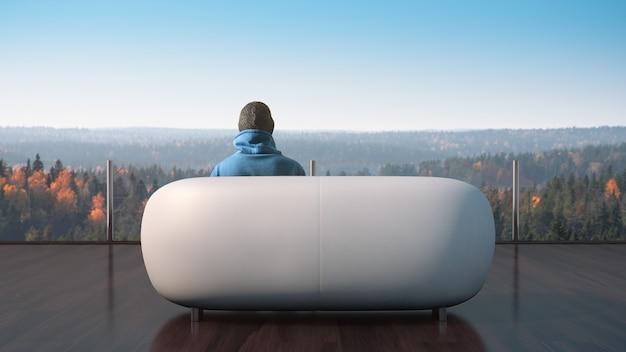 Человек сидит на террасе и наслаждается осенним пейзажем.