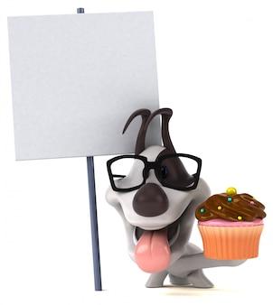 カップケーキと空白のボードで楽しい犬