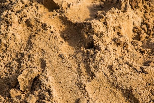 黄色の建物の砂のテクスチャをクローズアップ。
