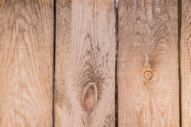 木の板に古いひびの入ったペイントのテクスチャ。