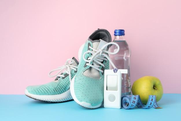 ピンクの背景に健康な糖尿病の概念。スポーツ糖尿病