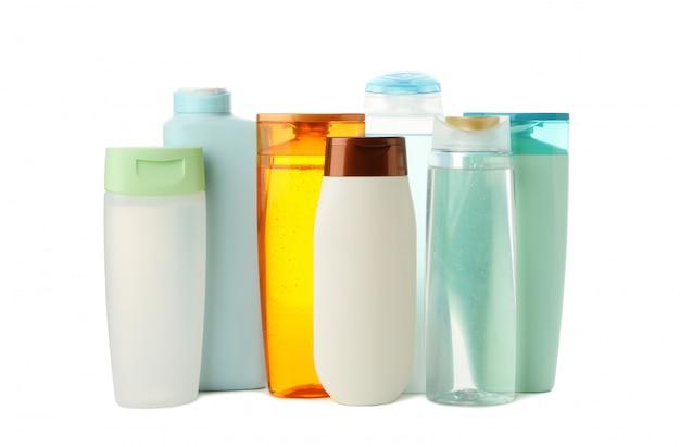 白い背景で隔離の化粧品の空のボトル