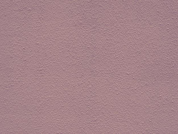 バックグラウンドの使用のためのピンクのコンクリート壁のテクスチャ。スモッキーピンクの荒い背景。濃いピンクの漆喰面。