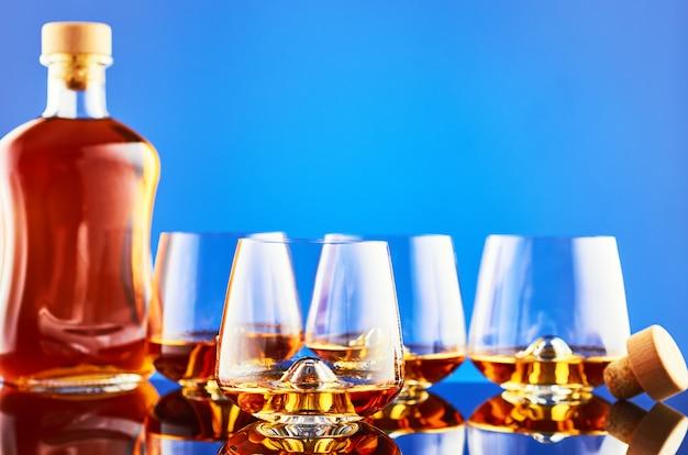 Виски на синей стене