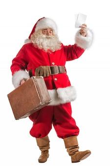 Санта-клаус со старым кожаным чемоданом