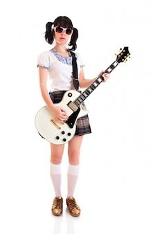 エレクトリックギターを持つティーンエイジャーの女の子