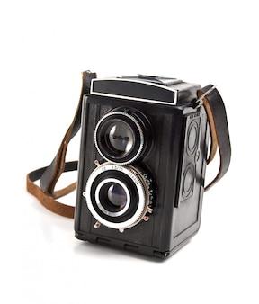 白で隔離される古いカメラ