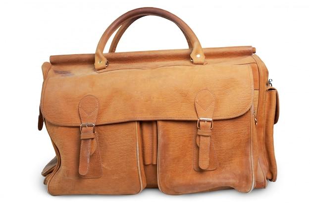 白い表面上に分離されて古い荷物バッグ