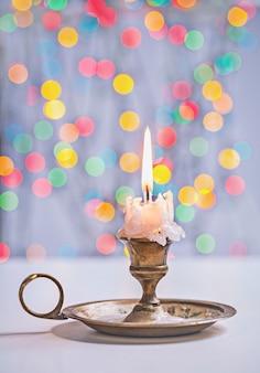 Винтаж перчатка свечи на фоне боке