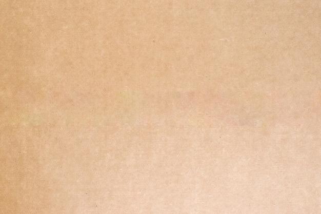 ライトブラウンのボール紙テクスチャ背景
