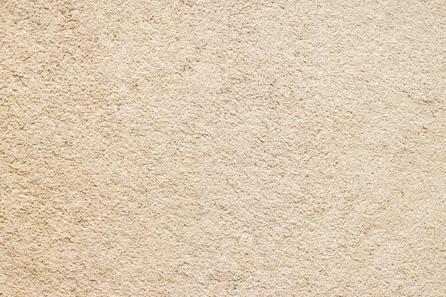 ベージュの明るい茶色の床のカーペットの生地のテクスチャ