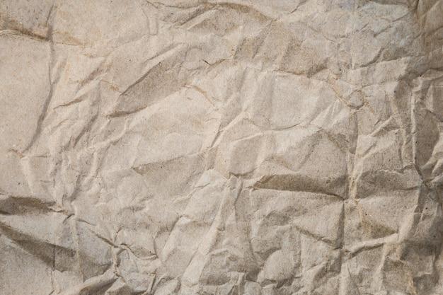 ウェブサイトの雑誌の背景組成の茶色のしわくちゃの紙の背景