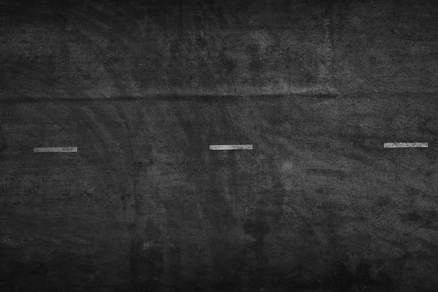Асфальтовая дорога текстуры с отметками колеса автомобиля на асфальте дороги вид сверху