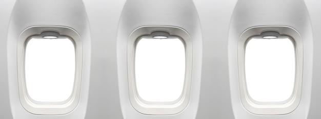 Объявление окон самолета размещено на пустых белых окнах самолета