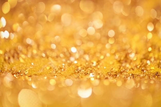 抽象的なゴールドグリスターボケ背景クリスマスライト