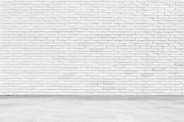 空の白い部屋、白い床の背景を持つきれいな白いレンガ壁のテクスチャ