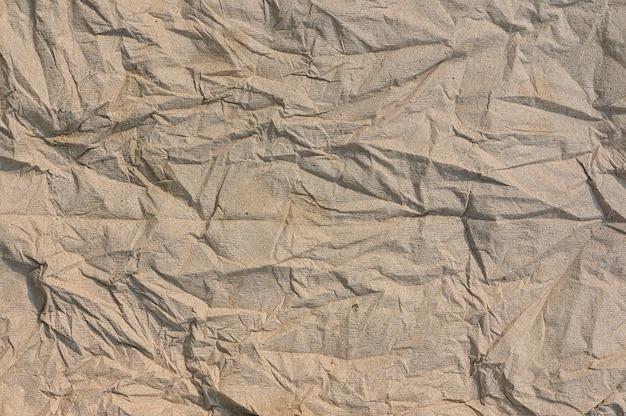 茶色のしわくちゃの紙のテクスチャの背景