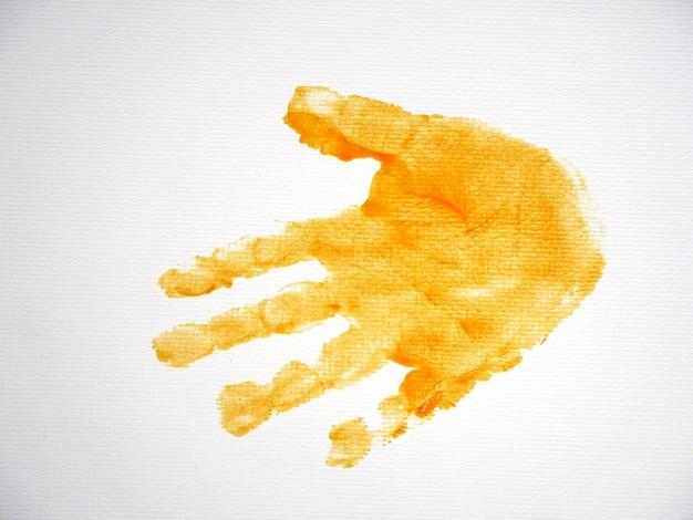 白い紙の背景に子供の手プリント