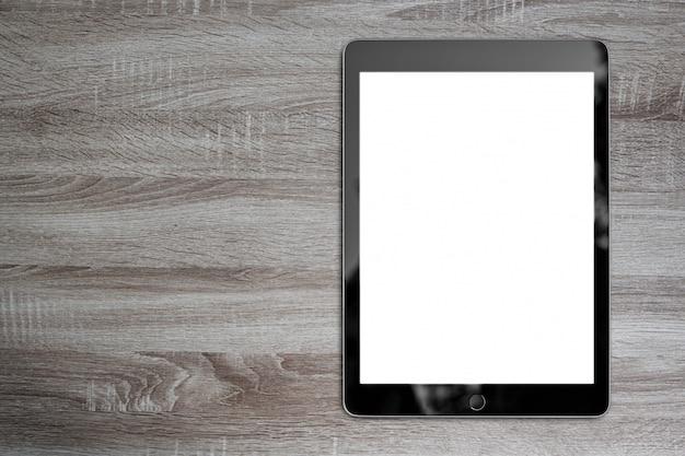 背景デザインのためのコピースペースとデジタルタブレット木製テーブル