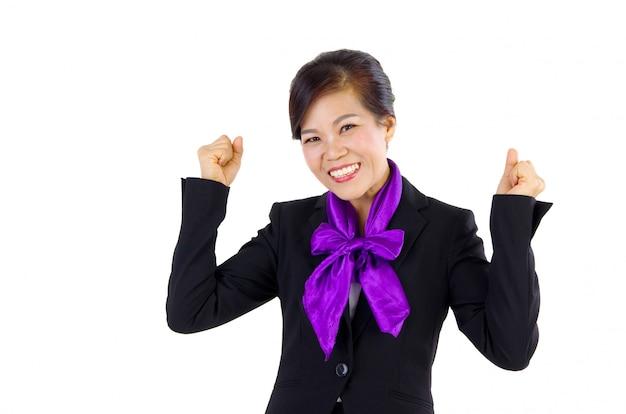 白い背景の上の成功のジェスチャーで幸せな中年ビジネス女性