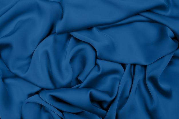 背景の生地の光沢のあるシルク。あなたのデザインのコンセプト。