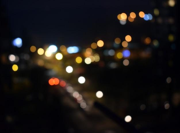 輝くビンテージライトの背景。ダークゴールドとブラック。デフォーカス