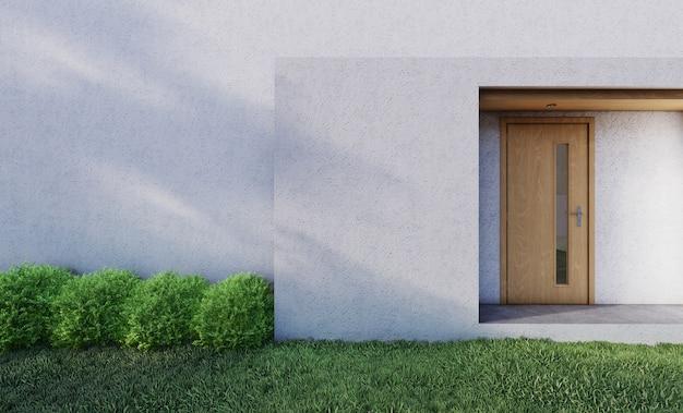 芝生と低木があるモダンな家の玄関ドアの前。