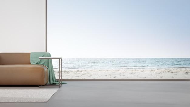 Диван на бетонном полу большой гостиной в современном доме или роскошной гостинице.