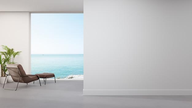 モダンな家の広いリビングルームのコンクリートの床のアームチェア