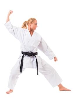 白の拳を示すクローズアップ女性アスリート