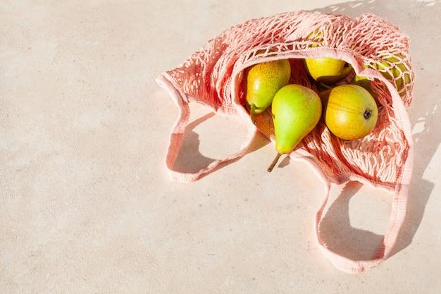フルーツ梨、再利用可能なメッシュコットンバッグ、プラスチック不要の廃棄物ゼロのコンセプト