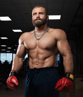 Боец боксер на черном фоне