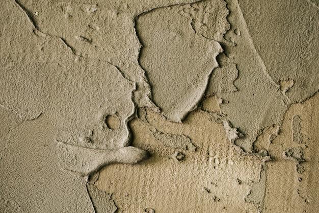 Серая старая штукатурка стены текстуры фона