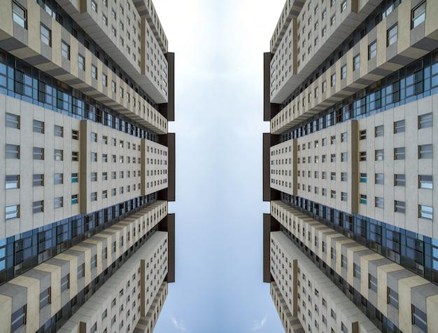 青い空に超高層ビルの底面図