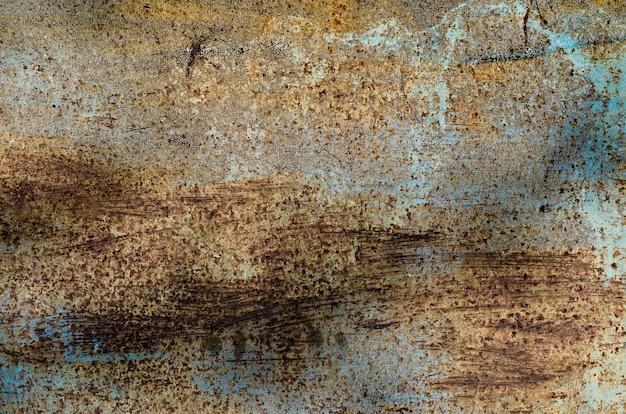 Темный изношенный ржавый фон текстуры металла.