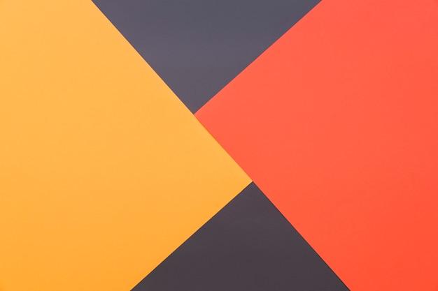 Геометрический фон желтый, красный и черный