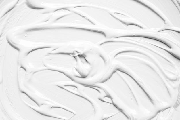 白色の抽象的な塗料層