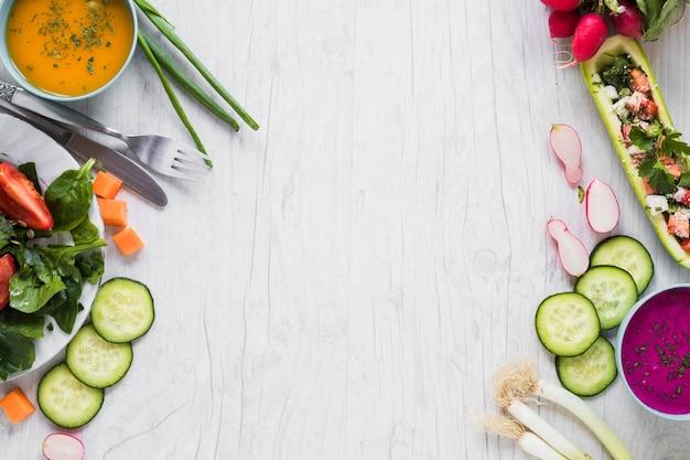 Овощи и супы на белом