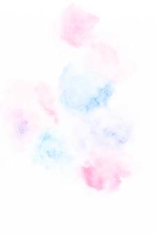 青とピンクの塗料の滑らかな滴